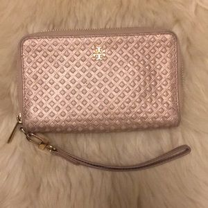 Tory Burch wristlet golden pink color.
